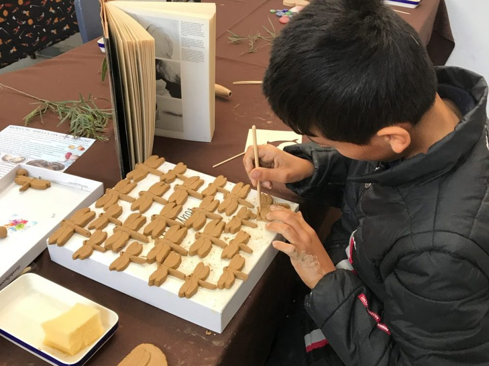 Young boy creating a dragonfly mobile at arts workshop 18.8.18